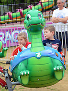 Reese Berkowitz (left), 5 and AJ Berkowitz, 7 both of Jamison, Pennsylvania enjoy a ride during Southampton Days Carnival as part of their July 4th celebration Saturday July 4, 2015 in Upper Southampton, Pennsylvania. (Photo by William Thomas Cain)