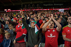CARDIFF, WALES - Tuesday, October 13, 2015: Wales supporters celebrate qualifying for the finals following a 2-0 victory over Andorra during the UEFA Euro 2016 qualifying Group B match at the Cardiff City Stadium. (Pic by Ian Cook/Propaganda)