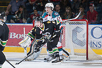 KELOWNA, CANADA - JANUARY 26: JT Barnett #17 of the Kelowna Rockets looks for the pass while checked by  Sawyer Lange #5 of the Prince Albert Raiders at the Kelowna Rockets on January 26, 2013 at Prospera Place in Kelowna, British Columbia, Canada (Photo by Marissa Baecker/Shoot the Breeze) *** Local Caption ***