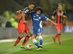 Bournemouth's Callum Wilson battles for the ball with Cardiff City's Fabio - Photo mandatory by-line: Alex James/JMP - Mobile: 07966 386802 - 17/03/2015 - SPORT - Football - Cardiff - Cardiff City Stadium - Cardiff City v AFC Bournemouth - Sky Bet Championship