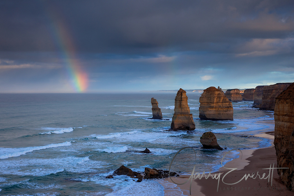 Stormy morning at the 12 Apostles, sun breaking through to produce a nice rainbow.
