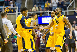 Dec 21, 2015; Morgantown, WV, USA; West Virginia Mountaineers guard Jaysean Paige (5) celebrates with teammates after making consecutive three pointers during the first half against the Eastern Kentucky Colonels at the WVU Coliseum. Mandatory Credit: Ben Queen-USA TODAY Sports