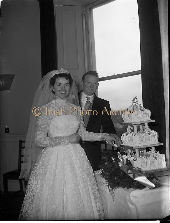 18/02/1957<br /> 02/18/1957<br /> 18 February 1957<br /> Wedding Dr K. Murphy and J. Fitzgerald at St. Mary's Church, Haddington Road and reception at Salthill Hotel, Monkstown. Bride and Groom  cutting the cake at the reception.