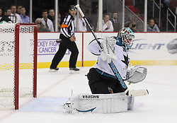 Oct 21; Newark, NJ, USA; San Jose Sharks goalie Antti Niemi (31) makes a blocker save during the second period at the Prudential Center.