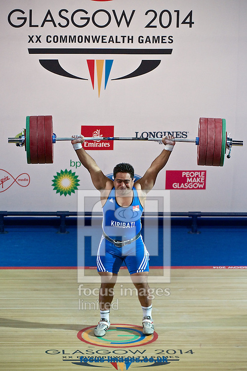 David Katoatau of Kiribati makes the final lift to win his country's first ever medal after winning the Men's 105kg final on Weightlifting Day Seven at Clyde Auditorium during Glasgow 2014 Commonwealth Games <br /> Picture by Ian Wadkins/Focus Images Ltd +44 7877 568959<br /> 30/07/2014