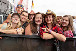 June 19, 2018 - Oshkosh, Wisconsin, U.S - Attendees close to the stage during Country USA Music Festival at Ford Festival Park in Oshkosh, Wisconsin (Credit Image: © Daniel DeSlover via ZUMA Wire)