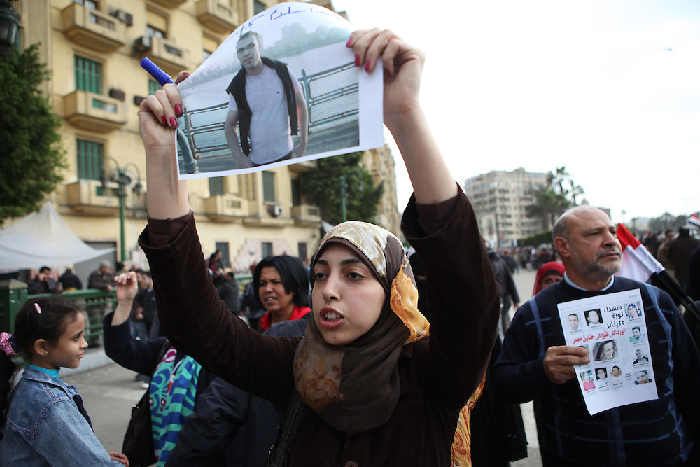 "On ""Sunday of the martyrs"" at Tahrir Square, an Egyptian woman holds a picture of one of the more than 300 people killed in clashes with government forces."