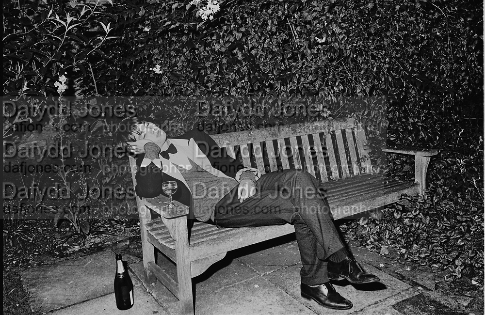 Member of the Bullingdon club asleep. Christchurch May Ball. Oxford 1983. SUPPLIED FOR ONE-TIME USE ONLY> DO NOT ARCHIVE. © Copyright Photograph by Dafydd Jones 248 Clapham Rd.  London SW90PZ Tel 020 7820 0771 www.dafjones.com