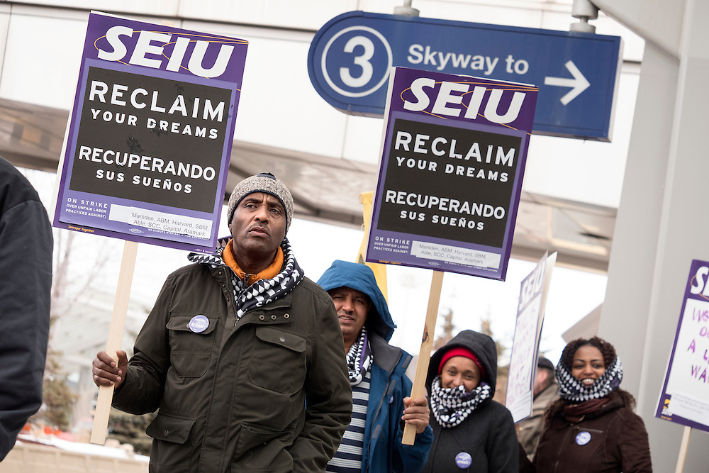 Hassan Kadir walks with Twin Cities janitors represented by Service Employees International Union during a picket for a wage increase at Minneapolis-St. Paul International Airport's Terminal 1 February 17, 2016.  The union is asking for $15 for both full and part-time workers.