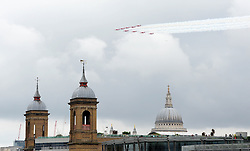 © Licensed to London News Pictures. 14/06/2014. London, England. Pictures of the Queen's official birthday flypast from  London Bridge during a lunchtime rain shower. Photo credit : Mike King/LNP
