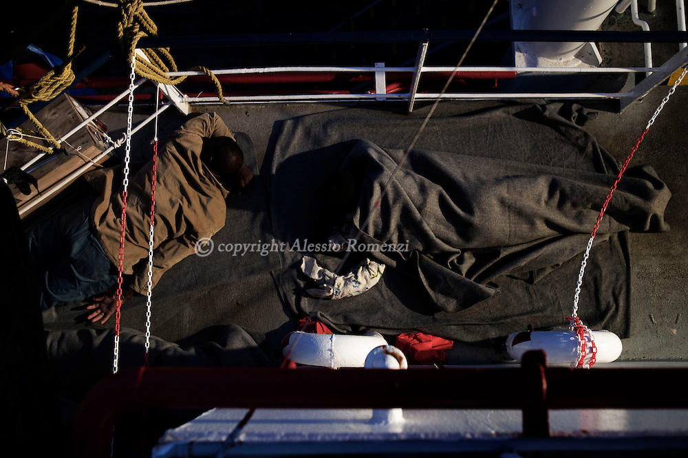 Italy: MSF Dignity1: Migrants rescued at sea sleep at night on the castle deck of the Dignity1on August 25, 2015. Alessio Romenzi