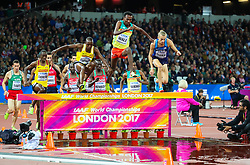 London, August 08 2017 . Early leader Getnet Wale, Ethiopia, is the first into the water jump ahead of Evan Jager, USA, and Jacob Araptany, Uganda, in the \mscf\ on day five of the IAAF London 2017 world Championships at the London Stadium. © Paul Davey.