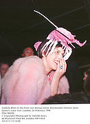 Isabella Blow in the front row during Julian Macdonald's fashion show. Queen's Gate tent. London. 24 February 1998<br />Film 9845f6<br />© Copyright Photograph by Dafydd Jones<br />66 Stockwell Park Rd. London SW9 0DA<br />Tel 0171 733 0108