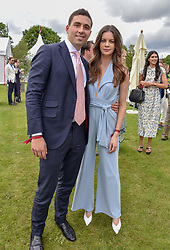 Sophia Goslitski and Adam Victor at the Cartier Queen's Cup Polo 2019 held at Guards Polo Club, Windsor, Berkshire. UK 16 June 2019. <br /> <br /> Photo by Dominic O'Neill/Desmond O'Neill Features Ltd.  +44(0)7092 235465  www.donfeatures.com