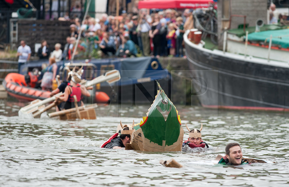 © Licensed to London News Pictures.16/07/2016. Bristol, UK.  Cardboard boat race at the Bristol Harbour Festival. The boats must be made primarily of cardboard, and some sink. The festival started in 1971when a bunch of boat owners headed to the harbour to save<br /> the docks from being filled in. They succeeded, and the Bristol Harbour Festival has been going ever since. This year's maritime programme features sea rescue<br /> dogs, historic ships, boat racing, flyboarding, steamboats and more. Photo credit : Simon Chapman/LNP
