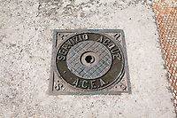 ANGUILLARA SABAZIA (LAKE BRACCIANO), ITALY - 26 JULY 2017: An ACEA technicians (the Roman city water utility) sewer cover is seen here by the the ACEA collecting water unit by Lake Bracciano, whose level has dropped more than 1,50 meters recently, in Anguillara Sabazia (Lake Bracciano), Italy, on July 26th 2017.<br /> <br /> Lake Bracciano provides eight percent of Rome's water and has sunk about 1.5 meters<br /> <br /> A severe drought and sweltering temperatures have led Rome city officials to consider a potential rationing of drinking water for eight hours a day for a million and a half Rome residents. The water crisis has become yet another sign of man being at the mercy of an increasingly extreme climate, but also of once mighty Rome's political impotence, managerial ineptitude and overall decline.Lake Bracciano provides eight percent of Rome's water and has sunk about 1.5 meters<br /> <br /> A severe drought and sweltering temperatures have led Rome city officials to consider a potential rationing of drinking water for eight hours a day for a million and a half Rome residents. The water crisis has become yet another sign of man being at the mercy of an increasingly extreme climate, but also of once mighty Rome's political impotence, managerial ineptitude and overall decline.