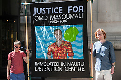 © Licensed to London News Pictures. 26/08/2016. London, UK. Members of the International Alliance Against Mandatory Detention gather outside the Australian high commission on The Strand to take part in the Nauru Files reading.  More than 2,000 leaked incident reports from Australia's detention camp for asylum seekers on the remote Pacific island of Nauru, published recently by The Guardian newspaper, will be read out in a 10-hour protest.  The reports detail the personal accounts of sexual abuse, torture and humiliation inflicted on children held by Australia in offshore detention. Photo credit : Stephen Chung/LNP