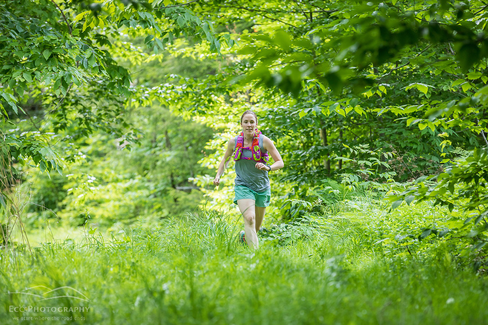 A woman running in the new Bethel Community Forest in Bethel, Maine.