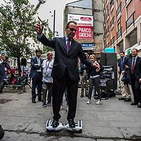 Milan, Italy - 11-06-2016: Center-right Milan mayoral candidate, Stefano Parisi, rides an hoverboard before a public meeting in Corso Garibaldi
