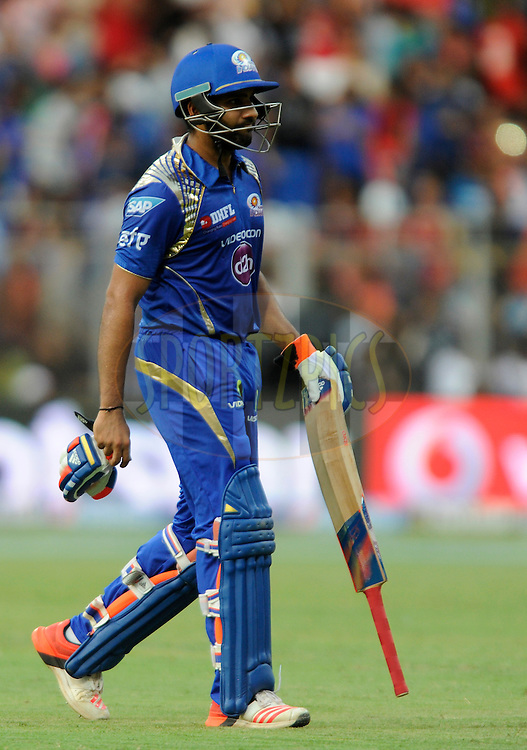 Rohit Sharma captain of Mumbai Indians walks back after getting out during match 46 of the Pepsi IPL 2015 (Indian Premier League) between The Mumbai Indians and The Royal Challengers Bangalore held at the Wankhede Stadium in Mumbai, India on the 10th May 2015.<br /> <br /> Photo by:  Pal Pillai / SPORTZPICS / IPL