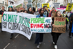 London, UK. 1st December, 2018. Environmental campaigners take part in the Together for Climate Justice demonstration in protest against Government policies in relation to climate change, including Heathrow expansion and fracking. Following a rally outside the Polish embassy, chosen to highlight the UN's Katowice Climate Change Conference which begins tomorrow, protesters marched to Downing Street.
