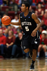Dec 22, 2011; Stanford CA, USA;  Butler Bulldogs guard Ronald Nored (5) dribbles the ball against the Stanford Cardinal during the second half at Maples Pavilion. Butler defeated Stanford 71-66. Mandatory Credit: Jason O. Watson-US PRESSWIRE