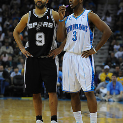 Jan 18, 2010; New Orleans, LA, USA; New Orleans Hornets guard Chris Paul (3) and San Antonio Spurs guard Tony Parker (9) talk on the court during the first half at the New Orleans Arena. Mandatory Credit: Derick E. Hingle-US PRESSWIRE