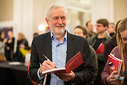 © Licensed to London News Pictures. 10/02/2018. London, UK. Labour Party Leader Jeremy Corbyn signs a manifesto for a supporter at a Labour Party conference on alternative models of ownership following the collapse of construction firm Carillion and the termination of the East Coast rail franchise. Photo credit: Rob Pinney/LNP