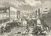 Busy street  scene in Denver, Colorado, 1875. Engraving.