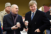 Koning Willem-Alexander is aanwezig bij de herdenking van de Februaristaking. Op 25 februari 1941 legden duizenden werknemers in Amsterdam en omgeving het werk neer uit protest tegen het optreden van de Duitse bezetter tegen de joden. <br /> <br /> King Willem-Alexander was present at the commemoration of the February strike. On February 25, 1941 put thousands of workers in Amsterdam and around the work down in protest against the actions of the Germans against the Jews.<br /> <br /> Op de foto / On the photo: <br />  De koning in gesprek na de kranslegging onder het genot van een kopje warmechocolademelk<br /> <br /> The king in conversation after the ceremony while sipping a cup of hot cocoa