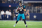 ARLINGTON, TX - OCTOBER 14:  Blake Bortles #5 of the Jacksonville Jaguars looks downfield for a receiver during a game against the Dallas Cowboys at AT&T Stadium on October 14, 2018 in Arlington, Texas.  The Cowboys defeated the Jaguars 40-7.  (Photo by Wesley Hitt/Getty Images) *** Local Caption *** Blake Bortles