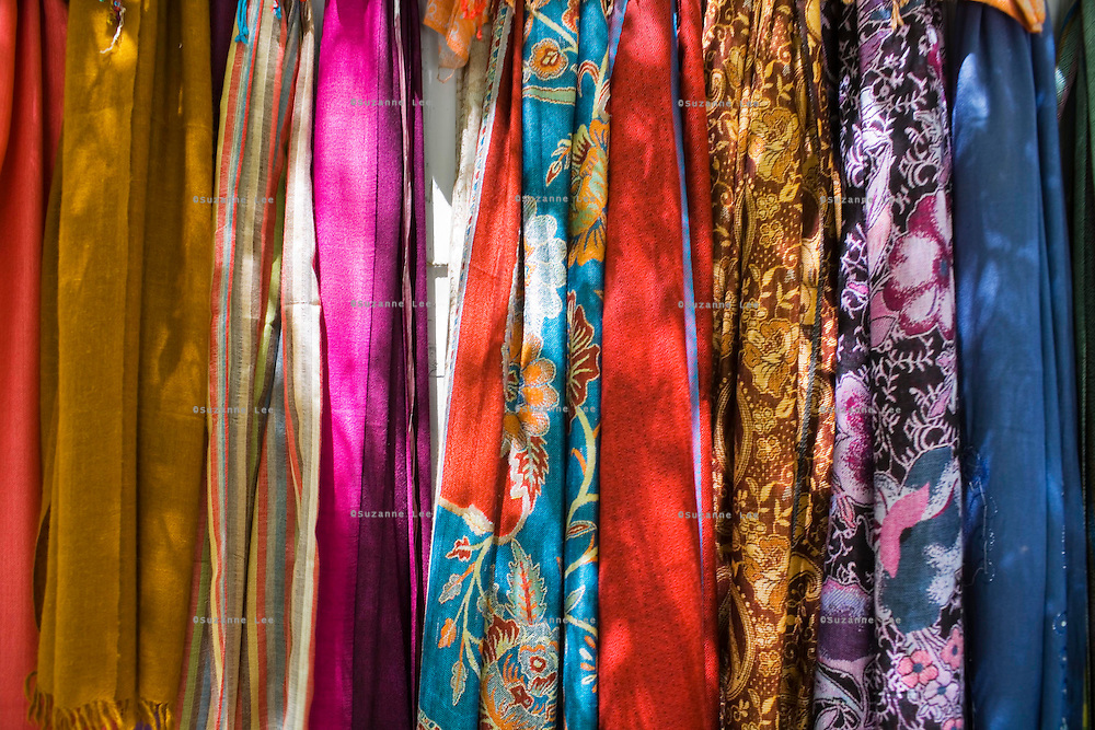 Multicolored Pashmina scarves are hung up for display and sale in Leh, Ladakh, Jammu & Kashmir, on 7th June 2009 as life and business in and around Leh town come to life as the first tourists arrive before summer season in this town of 3505m in the Himalayan mountains, India.  Photo by Suzanne Lee