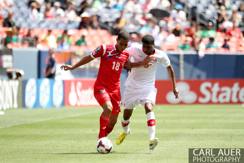 July 14 2013:  Panama Midfield Jairo Jimenez (18) attempts to keep the ball from Canada Defender Ashtone Morgan (3) during the second half of the CONCACAF Gold Cup soccer match between Panama and Canada at Sports Authority Field in Denver, CO. USA.