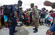 Royal Bahamas Defense Forces and Royal Bahamas Police help evacuees gathered at Marsh Harbour Port in Abaco on Friday, September 6, 2019 awaiting to leave the island after Hurricane Dorian swept through the Bahamas.