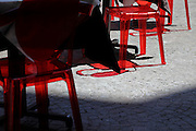red transparent chairs reflection on a outdoor public cafe terrace