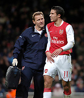 Photo: Ed Godden.<br /> Arsenal v CSKA Moscow. UEFA Champions League, Group G. 01/11/2006. Arsenal's Robin Van Persie leaves the pitch for medical attention.