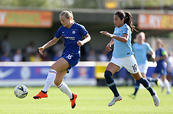 Chelsea's Magdalena Eriksson (left) and Manchester City's Nadia Nadim battle for the ball during the FA Women's Super League match at Kingsmeadow, London.