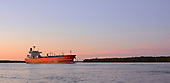 Images of Methanol Tanker MT 'Taranaki Sun' Sailing under a Majestic Sunest in the Mississippi River