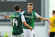 Stevie Mallan (#14) of Hibernian celebrates Hibernian's fourth goal (4-0) with Vykintas Slivka (#8) of Hibernian during the Europa League match between Hibernian and NSÍ Runavik at Easter Road, Edinburgh, Scotland on 12 July 2018. Picture by Craig Doyle.