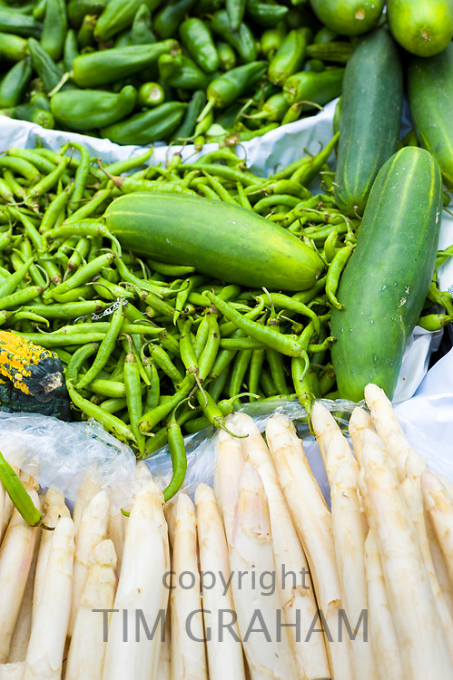 Vegetables - chillies, marrow, green pepper, salsify on sale in food market in Santander, Cantabria, Northern Spain
