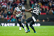 Houston Texans Running Back Carlos Hyde (23) pushes away Jacksonville Jaguars Defensive Back Jarrod Wilson (26) during the International Series match between Jacksonville Jaguars and Houston Texans at Wembley Stadium, London, England on 3 November 2019.