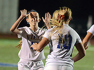 NEWTON, PA - NOVEMBER 4: Villa Joseph Marie's Megan O'Niell celebrates with Taylor Stevens #10 after their second goal of the game against Conrad Weiser in the first half of the PIAA Class AA first-round girls soccer playoff game November 4, 2014 in Newtown, Pennsylvania.  (Photo by William Thomas Cain/Cain Images)