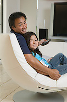 Father and Daughter Relaxing in Living Room