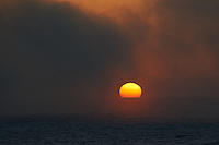 Pacific Sunset in Fog off the Mexican Coast. Image taken with a Nikon D3s and 70-300 mm VR lens (ISO 200, 300 mm, f/5.6, 1/400 sec).