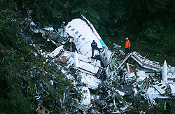 November 29, 2016 - La Ceja, Antioquia, Colombia - The wreckage of a LaMia airlines charter plane carrying members of the Chapecoense Real football team is seen after it crashed in the mountains of Cerro Gordo, Colombia. At least 75 people on board were killed; officials said six survived. The chartered plane was carrying Brazilian soccer team Chapecoense to an important match. (Credit Image: © Juan Antonio Sanchez/Fotoarena via ZUMA Press)