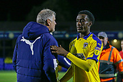AFC Wimbledon forward Zach Robinson (29) shakes the hand of AFC Wimbledon Manager Glyn Hughes after the EFL Trophy match between Southend United and AFC Wimbledon at Roots Hall, Southend, England on 13 November 2019.