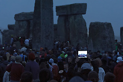 Summer Solstice<br /> Summer Solstice celebrations. This is the 14th year that English Heritage has provided free access to the stones. A very dull and bleak Summer Solstice reflects the ongoing poor British Summer of 2013,<br /> Stonehenge, Wiltshire, UK. <br /> Friday, 21st June 2013<br /> Picture by Rosalind  Butt / i-Images