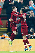 Liverpool midfielder Xherdan Shaqiri (23) and Liverpool defender Trent Alexander-Arnold (66) celebrate the third goal 3-0 during the Premier League match between Liverpool and Newcastle United at Anfield, Liverpool, England on 26 December 2018.
