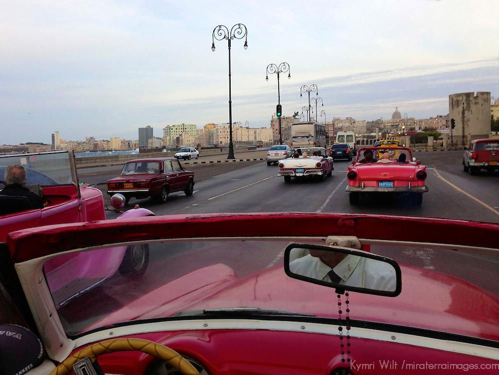 Central America, Cuba, Havana. Classic convertible driving on the Malecon in Havana.