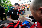 AFC Bournemouth defender Adam Smith signing his autograph on a shirt as he arrives for the Premier League match between Bournemouth and Burnley at the Vitality Stadium, Bournemouth, England on 13 May 2017. Photo by Graham Hunt.